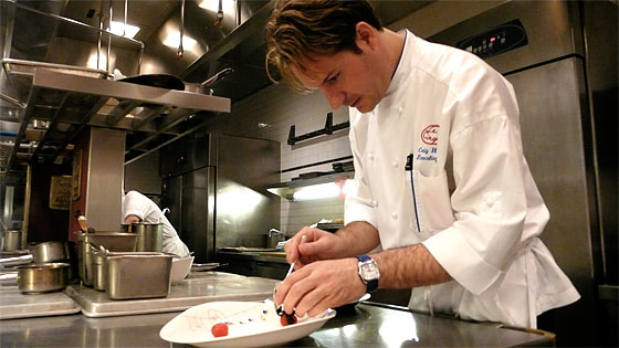 Craig Hopson plating something very fancy at Le Cirque.