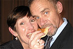 David Carr takes a bite from Cyndi Stivers.