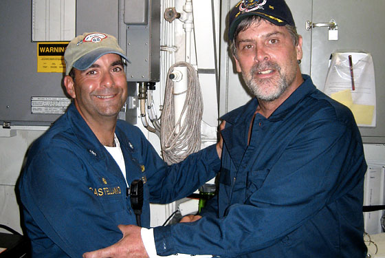 Captain Richard Phillips, right, with the commander of the USS Bainbridge.