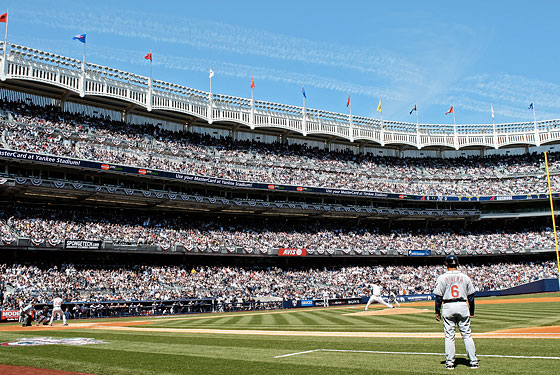 CC Sabathia throws the first official pitch at the new Yankee Stadium.