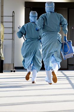 Is there anything scarier than people <i>running</i> in hazmat suits?