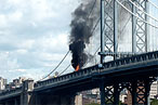 A burning garbage truck on the span this summer.