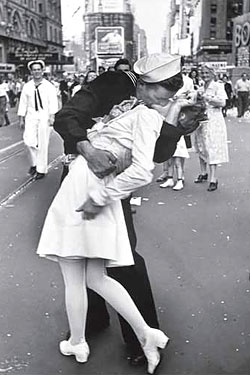 A young couple celebrates in the streets upon hearing the news.
