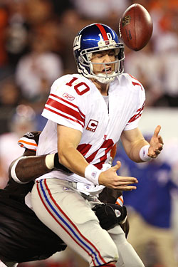 "Jealous of David Tyree's ""helmet catch,"" Eli Manning attempts a ""helmet throw,"" with disastrous results."