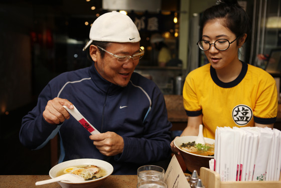 Morimoto braces himself for a third bowl of ramen at Setagaya.