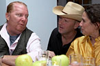 Tall-man-in-a-big-hat Jim Denevan chats with Mario Batali and wife Susi Cahn.