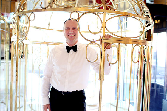 Waiter J.P. Behar in the birdcage at Sweetiepie.
