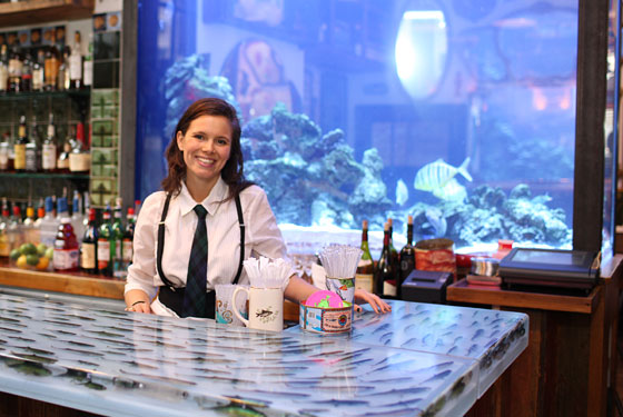 Alexis Sarandon by the notorious fish tank at the John Dory.