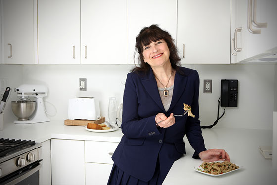 Ruth Reichl tastes some tripe in the Gourmet test kitchen.