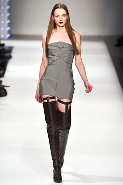 Thigh-high boots at Chalayan.
