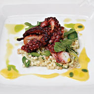 Grilled octopus with fregola and cara cara oranges.