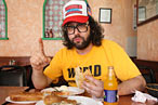 Comedian Judah Friedlander digs the cevapci at Sarajevo in Astoria.
