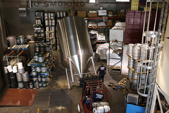 A vat is installed in the Greenpoint brewery.