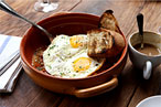 The eight-hour tripe with fried duck eggs at Locanda Verde.