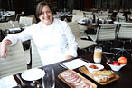 Missy Robbins samples salumi at A Voce Columbus.