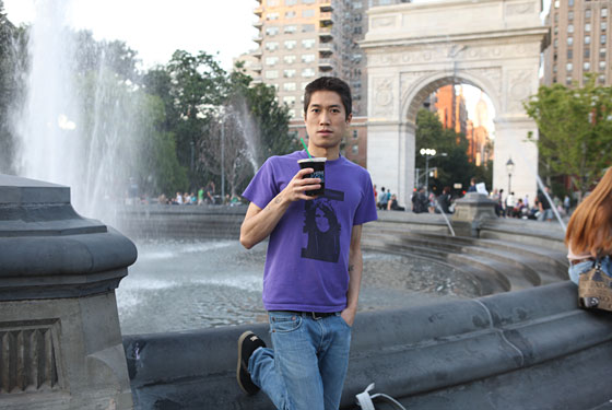 Writer Tao Lin sips iced Think Coffee in Washington Square Park.