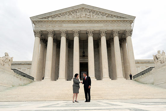 New justice Sonia Sotomayor with Chief Justice John Roberts.