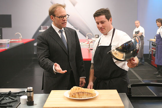 Alton Brown and Seamus Mullen consider a plate of ... something.