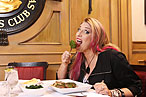 Lisa Lampanelli chomping on Colorado lamb chop with herb butter at the Friars Club.