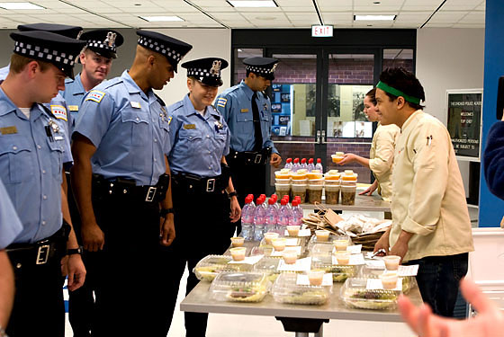 There's no way these Chicago cops were happy that this was a healthy-eating challenge. We know we weren't.