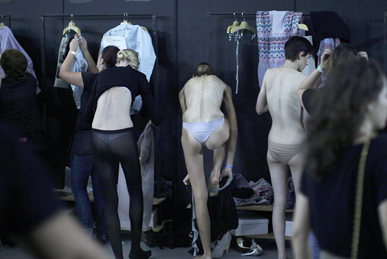 Nude fashion models changing backstage