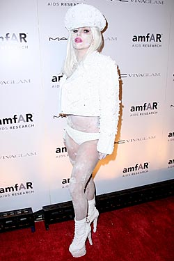 Gaga, in white at last week's amfAR gala.