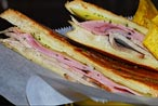 Bobby Flay Rides the PATH for a Cuban-Sandwich Throwdown