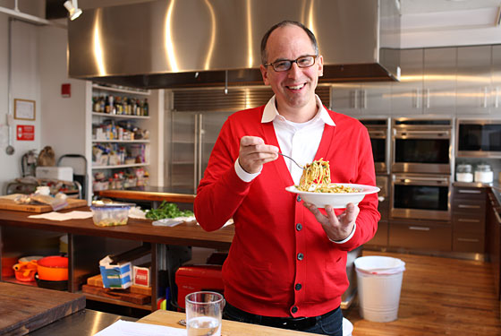 James Oseland eats leftovers in the Saveur kitchen.