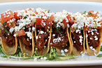 Shredded-beef mini-tacos at Sueños.