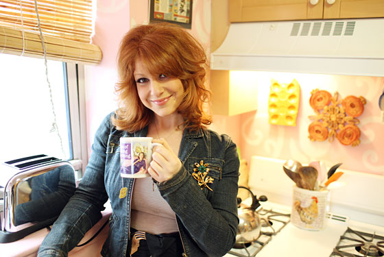 Julie Klausner has a cup of tea at home.