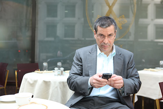 Gasparino checks his BlackBerry over lunch at San Pietro.
