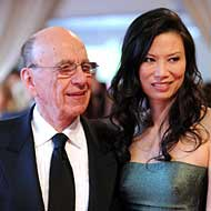 Murdoch last night with his wife, Wendi Deng.