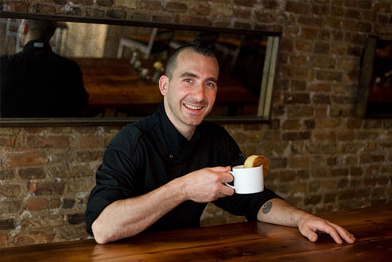 Forgione eats his cake-and-coffee breakfast at Restaurant Marc Forgione.