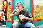 Bourdain: eating hot dogs, and crow.