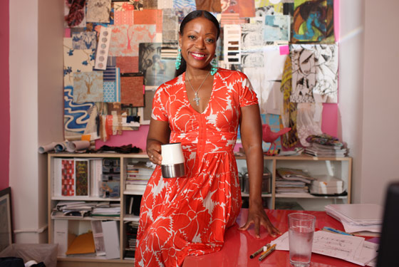 Reese sips a mug of tea in her studio.