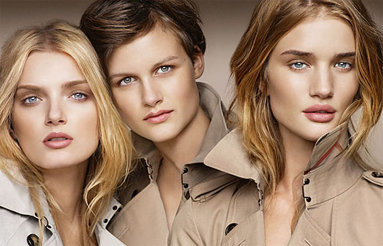 Lily Donaldson, Nina Porter, and Rosie Huntington-Whiteley rock trench coats