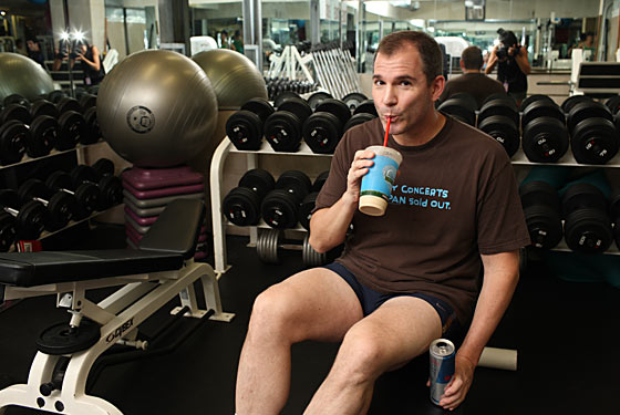 Bruni sips his Peanut Butter Split and Red Bull at the gym.