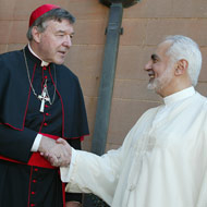 Rauf shaking the hand of a terrorist-sympathizing cardinal.