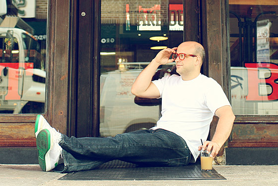 Holzman relaxing outside the Meatball Shop.