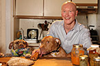 Writer Ian Knauer (and his dogs) in the kitchen.