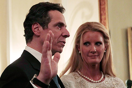 Cuomo getting sworn in this weekend, with girlfriend Sandra Lee looking on.