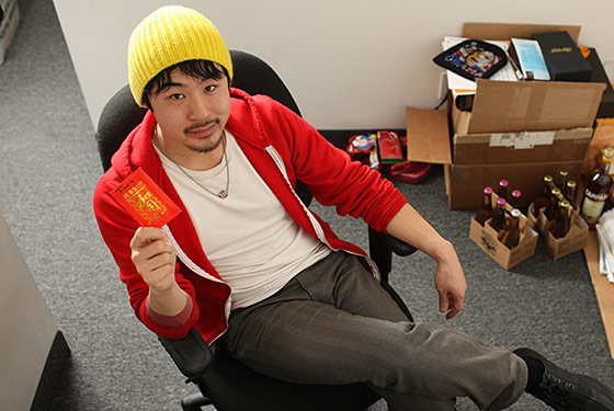 Francis Lam at his office, with a red envelope from Mom.