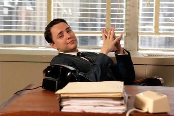 This Pete Campbell, at his desk. Sucking.